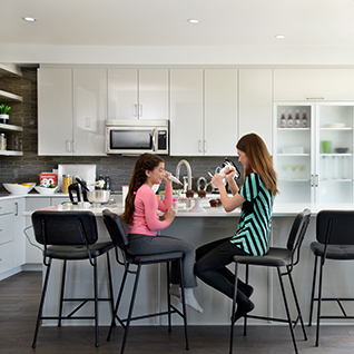 A girl and a woman spending time in a kitchen