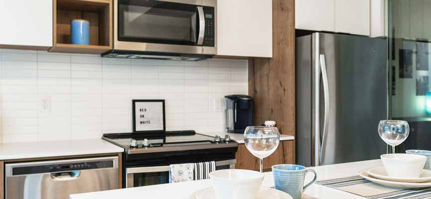 kitchen with microwave oven and dishwasher