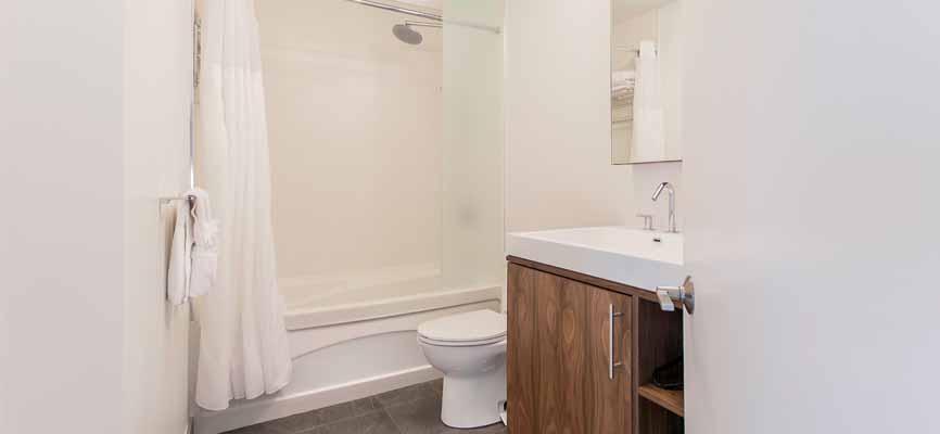 white bathroom with wood vanity