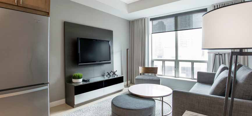 living room in Minto Yorkville with big windows