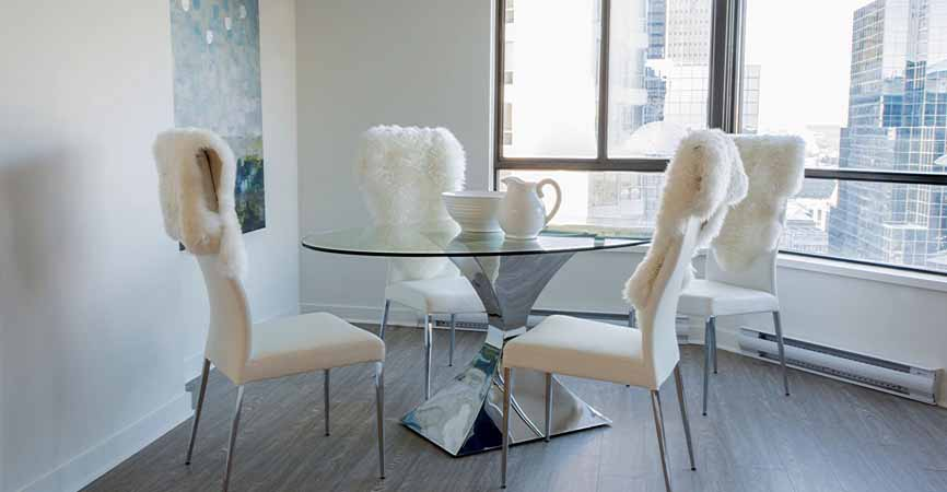 dining room in apartment with clear glass table top