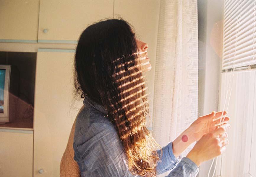 Woman adjusting her blinds