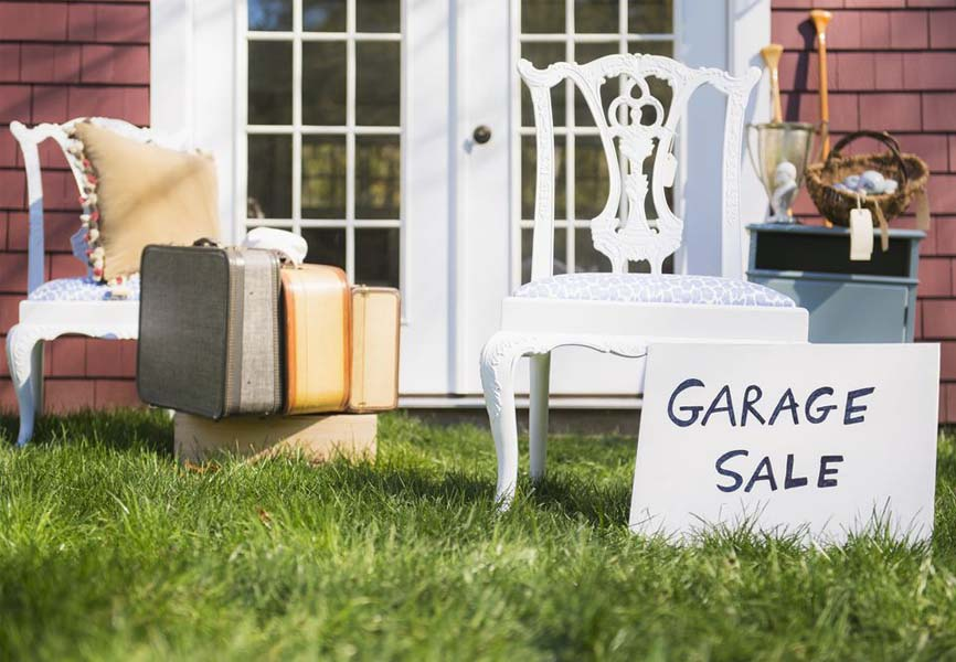 Garage Sale sign in front of old furniture