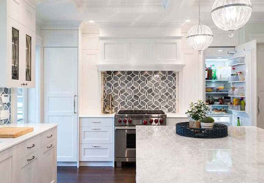 White granite kitchen countertop with white cabinets and top-of-the-line appliances