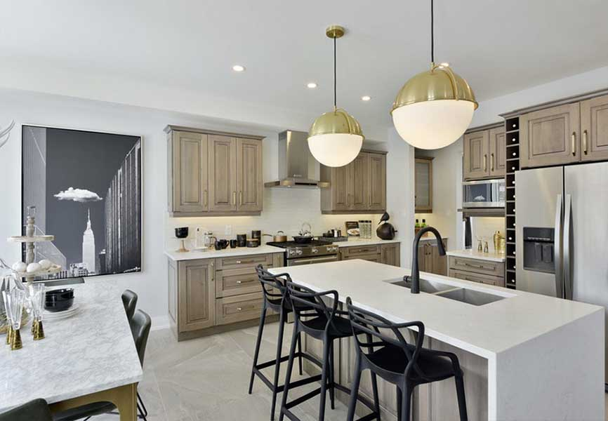 white kitchen island surrounded by wood cabinets