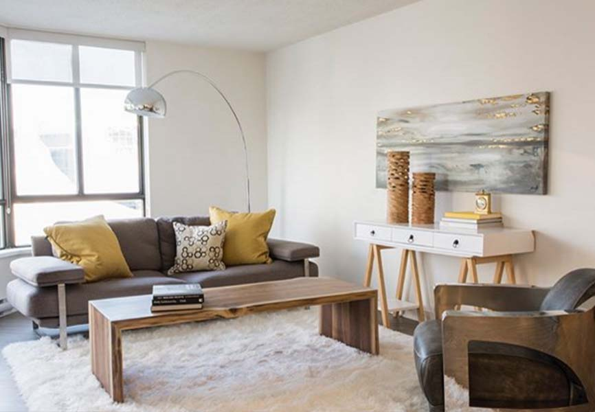 Apartment living room with couch, tables and lamp