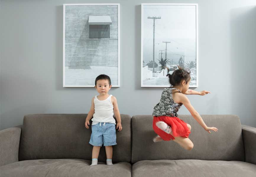 Kids playing on a couch