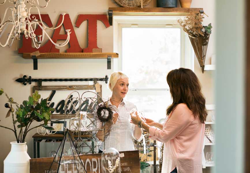 Two women talking in a local shop