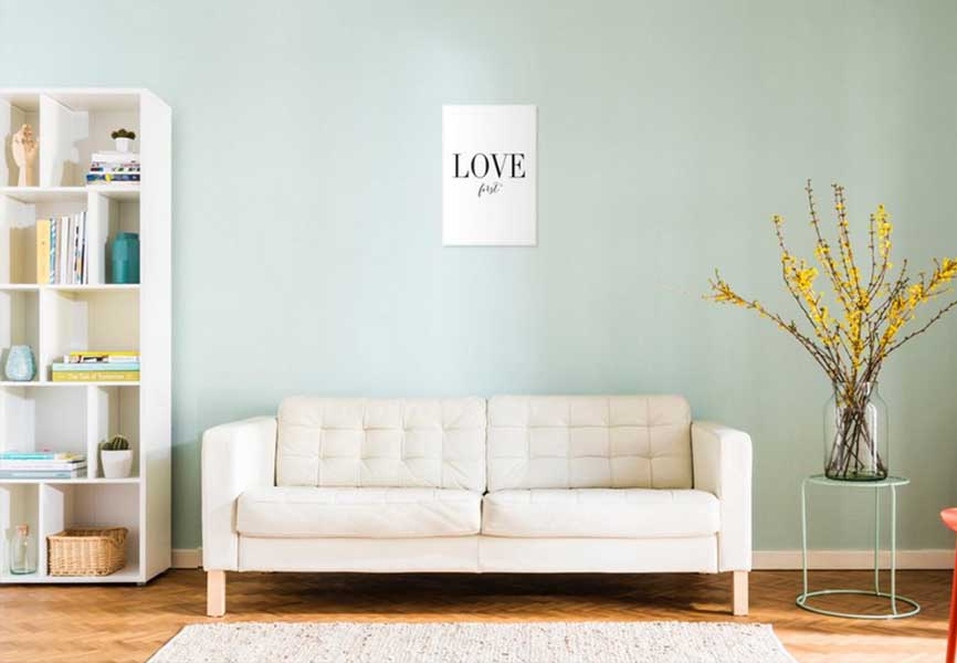 White couch in mint room