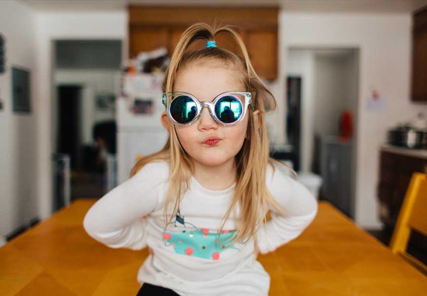 Little girl wearing funky sunglasses