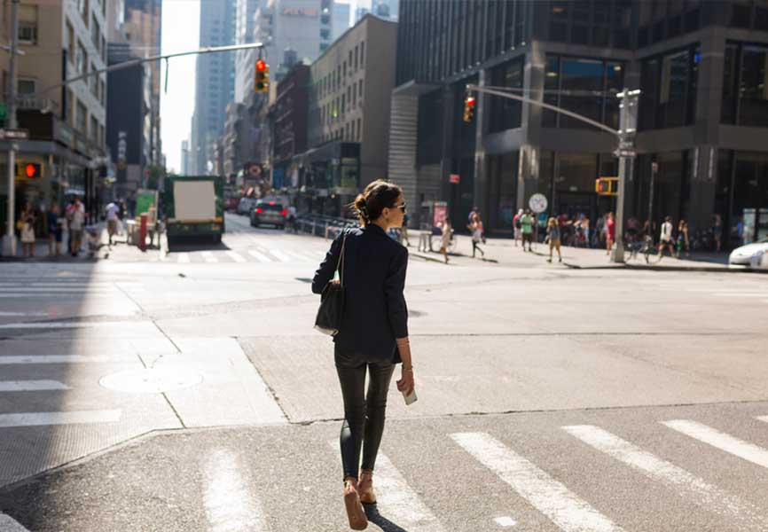 Woman walking at an intersection