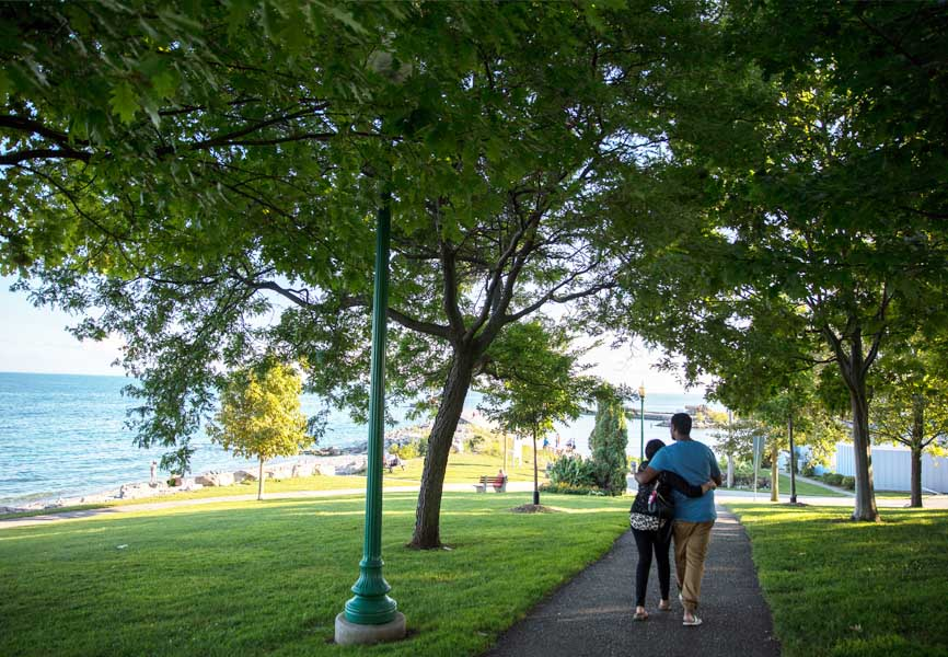 Oakville park with couple walking on trails