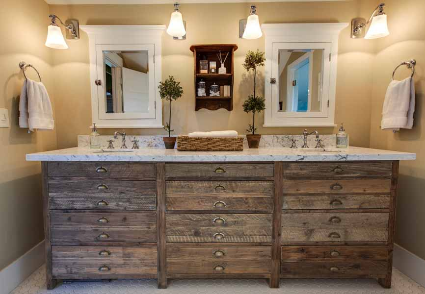 bathroom with wood vanity and plants on the counter
