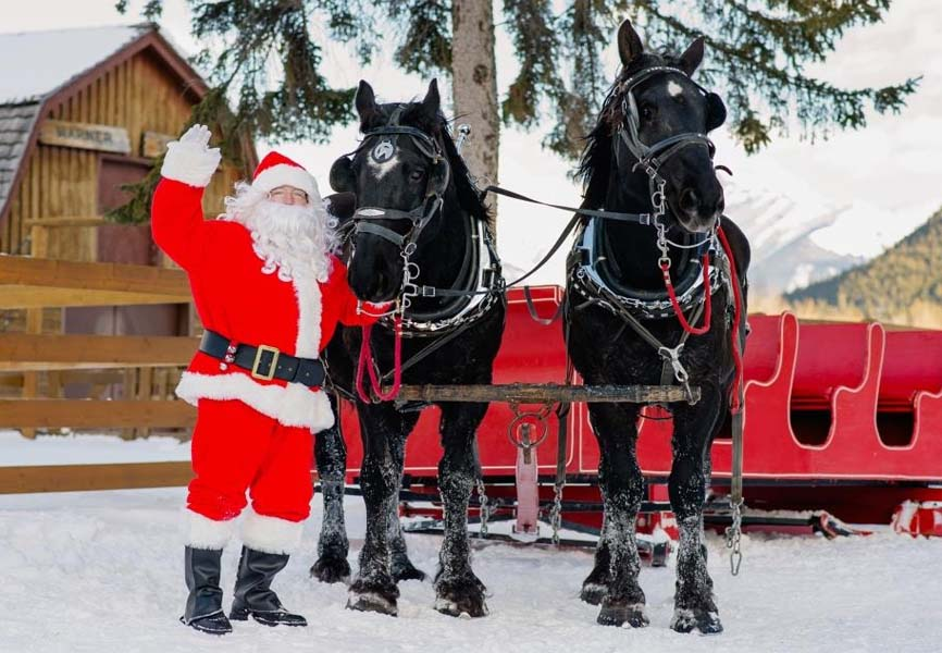 Santa with his two horses and his red sleigh