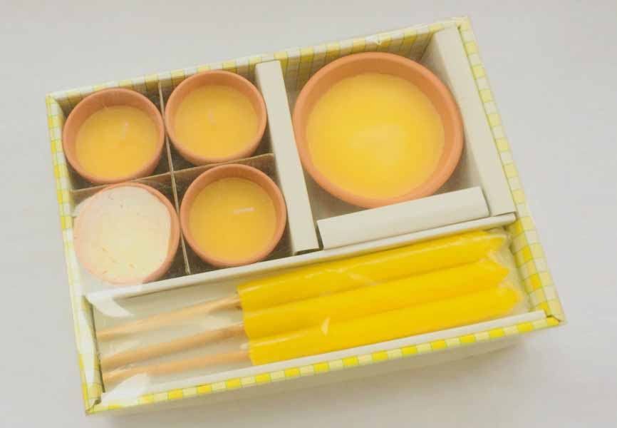 box with yellow citronella candles inside