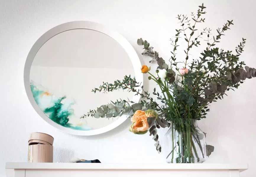 round mirror on mantle that's painted tye die