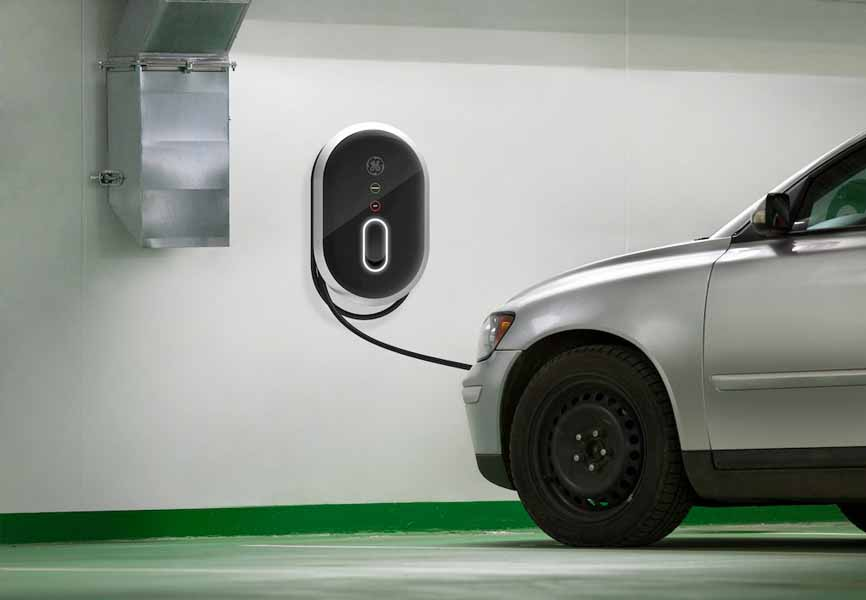 silver car plugged into electric charger
