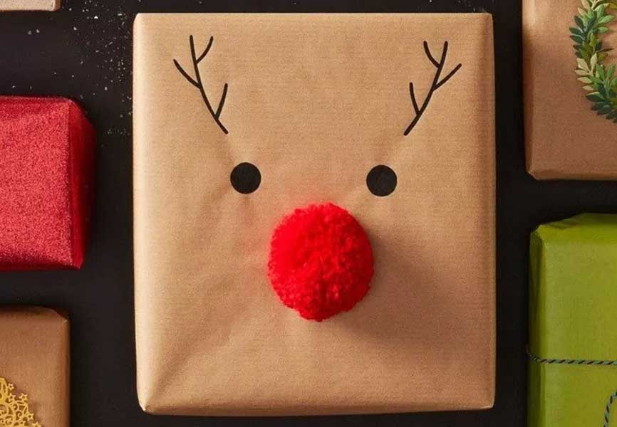 present wrapped in brown paper with Rudolph nose and antlers drawn on it