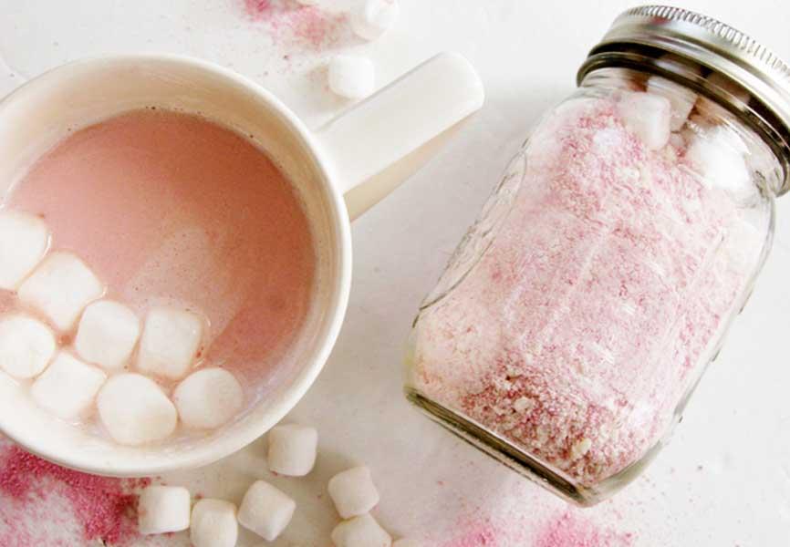 pink hot chocolate in a mason jar