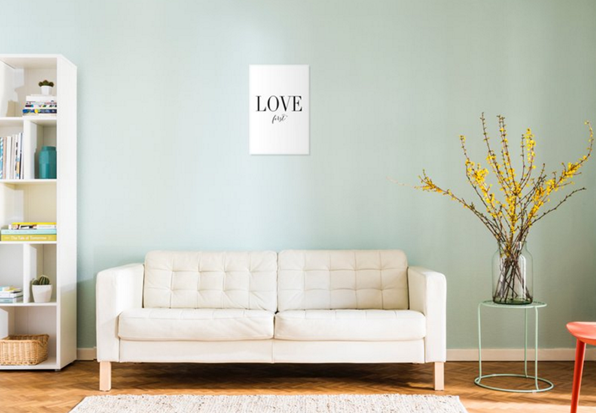 mint green living room with art on wall