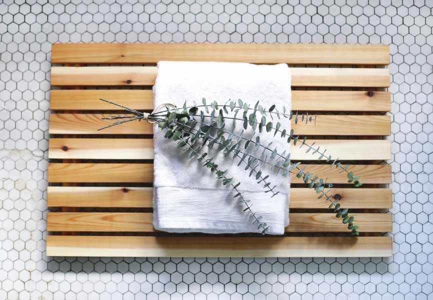 Spa style plant and towel on wood