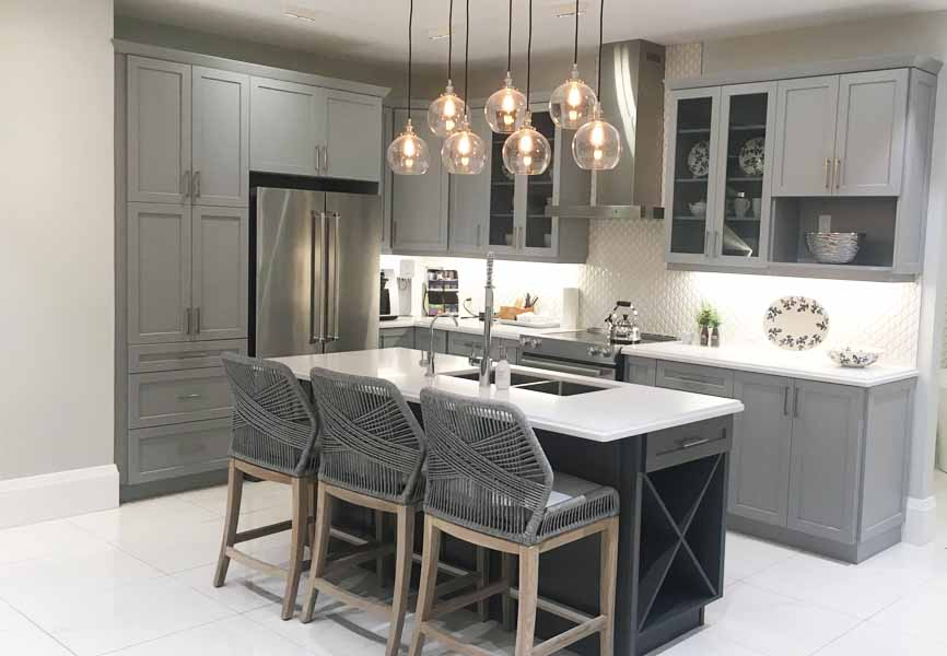 Quartz countertop kitchen with grey cabinets