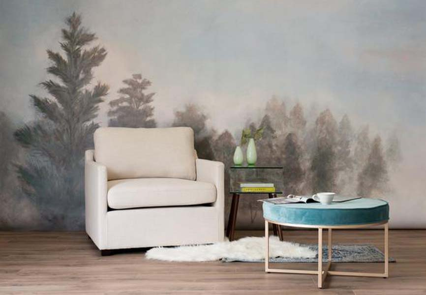 white chair in living room with English Countryside wallpaper mural on wall