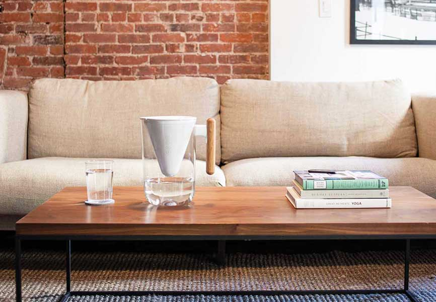 Soma water filter on coffee table in living room