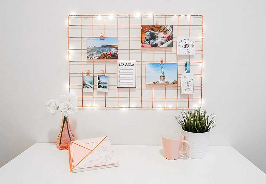pretty desk with string lights and photos clipped on a board