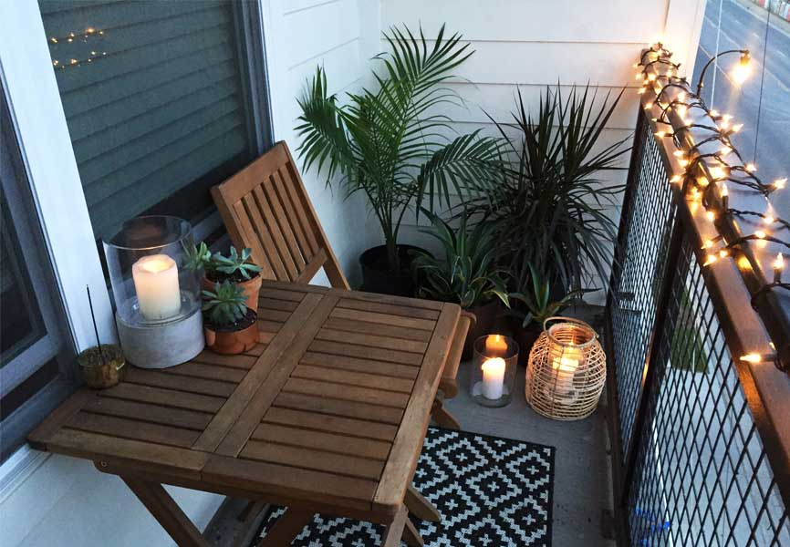 outdoor balcony garden with string lights