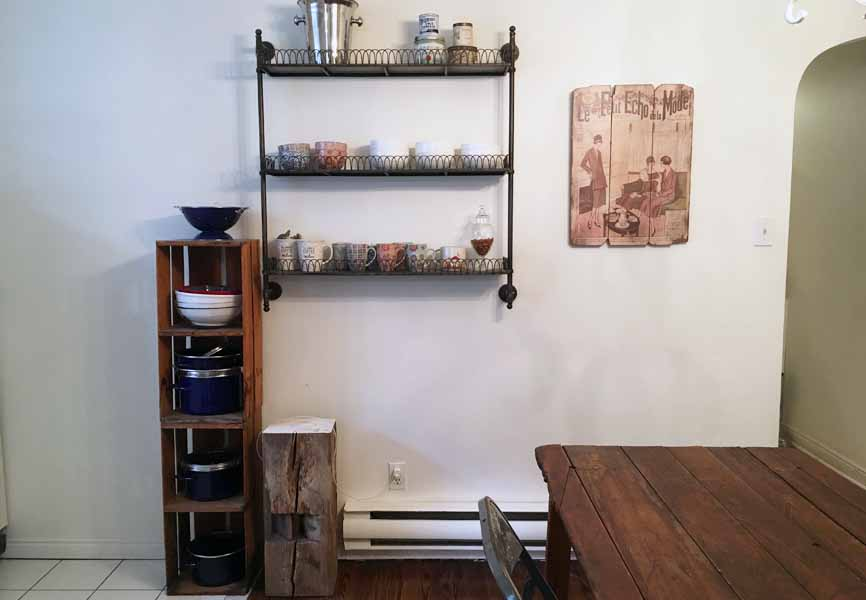 small apartment kitchen with wooden crates stacked holding dishes