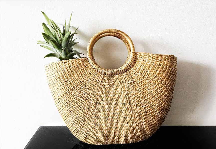 wicker basket with pineapple inside