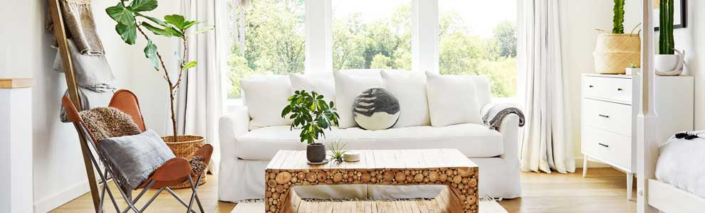 bright white living room at cottage with big windows