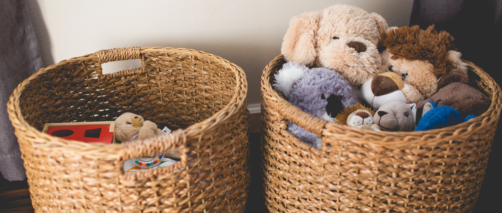 stuffed animals in two wicker baskets