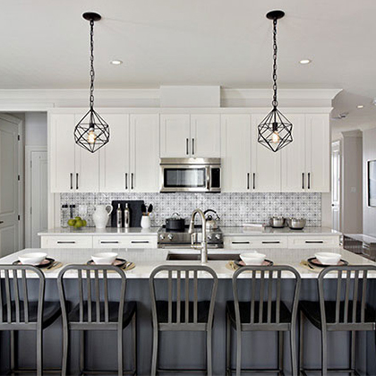Neutral coloured kitchen with a dark grey island and white cabinets