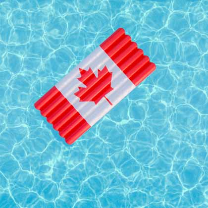Canada Day floatie floating in a blue pool