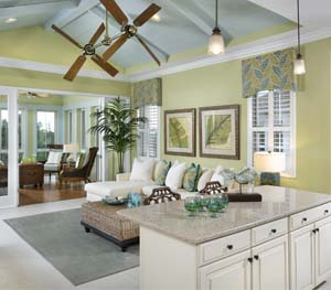 Open concept living area, including granite countertops and bright colors.
