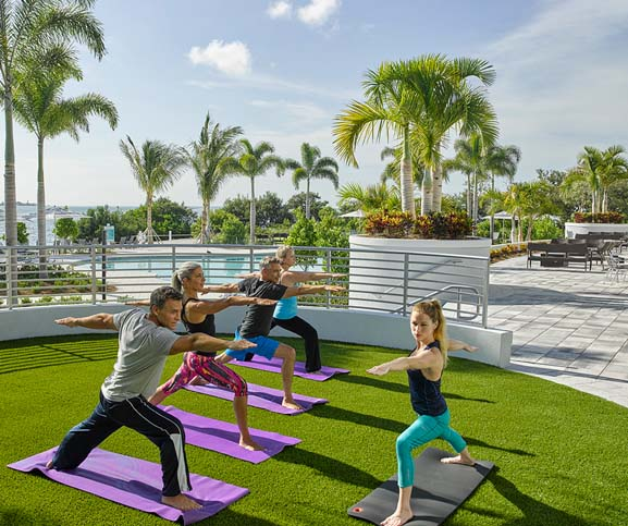 Yoga classes at Harbour Isle, just one of the amenities offered. Island Coach Homes now on sale.