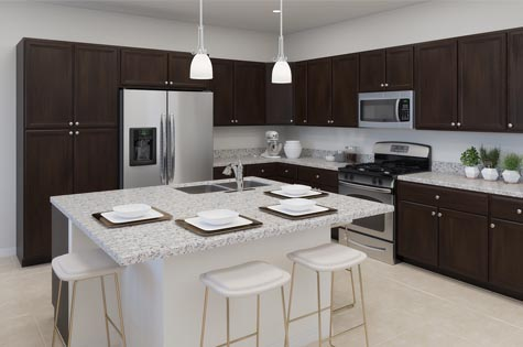 Kitchen includes granite countertops, brown cabinets and stainless steel appliances.