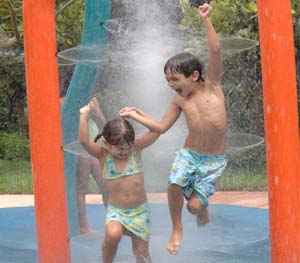 Children having fun at the waterworks outdoor park. Access to this and more included with an Artesia home.