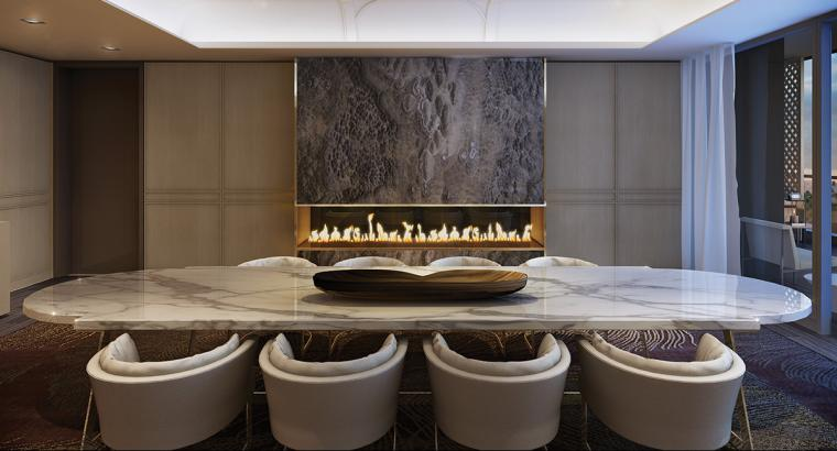 Dining room with granite table and a fireplace is available at Minto Yorkville Park