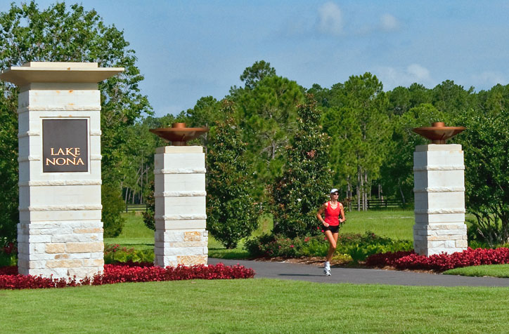 Woman jogging in Park at Lake Nona