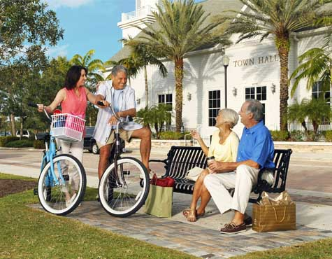 Biking in town at LakePark in Port St. Lucie. Homes now on sale.