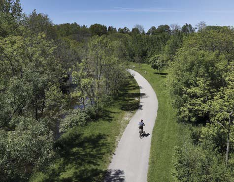 Biker on a trail in Mimco Creek, full of ravines and walking trails