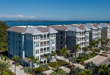 Waterfront Residences at One Particular Harbour is surrounded by greenery, and overlooks Anna Maria Sound