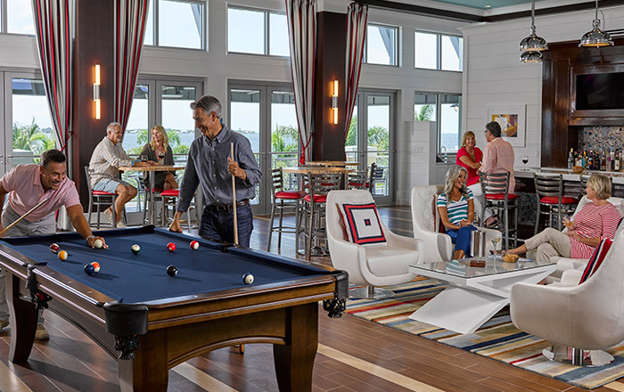 The second floor of The Beach Club invites you to play billiards, have a drink with friends or take in the waterfront views.