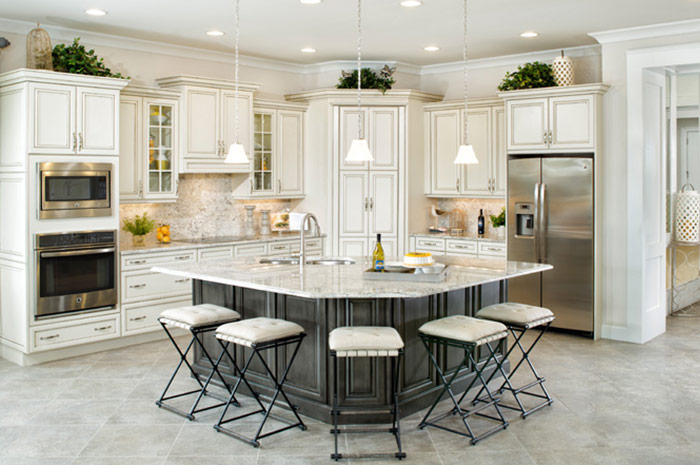 Luxury kitchen with stainless steel appliances and custom wood cabinets (Wisteria Shown)