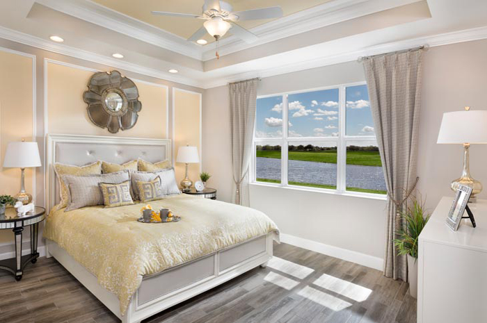 Beautiful master bedroom oasis with relaxing water views (Banyan Shown)