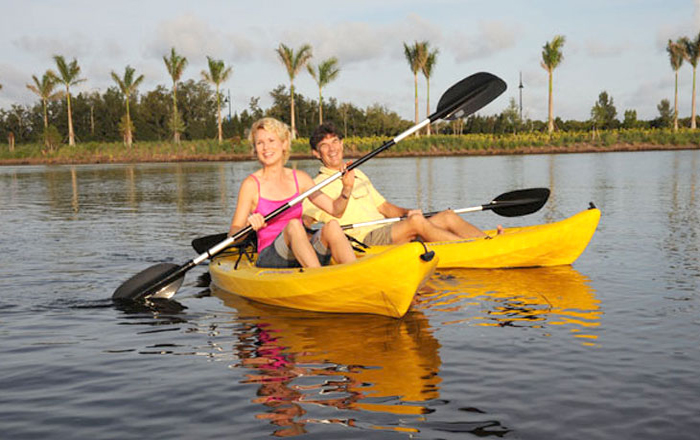 Live where you can catch dinner on your morning kayak and the sunset from home.