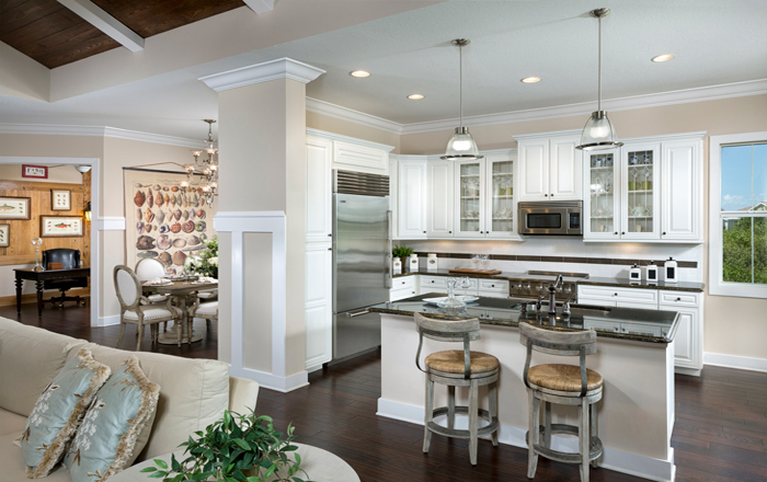 Beautiful coastal inspired kitchen with white wood cabinets and large center island (Harbour Grand Shown)